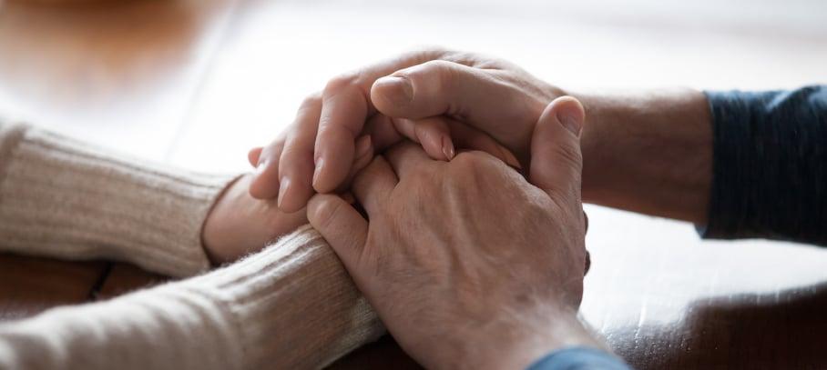 KoppPracticeArea-Couple-holding-hands-across-table_03