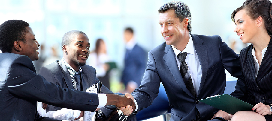 KoppPracticeArea-Four-Business-people-coming-to-agreement-and-handshaking_03