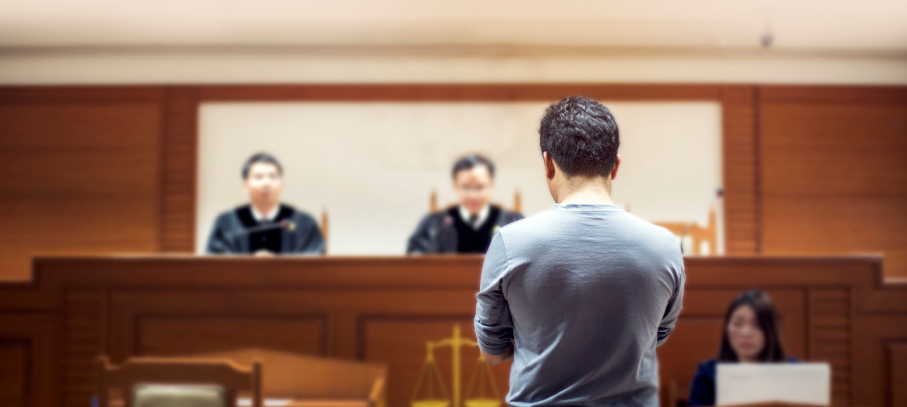 KoppPracticeAreas-Man-Standing-before-the-a-judge-at-the-court_03